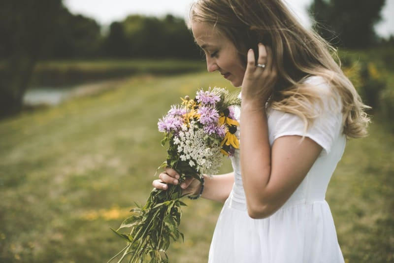 clairalient girl smelling flowers
